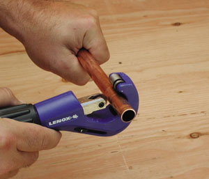While copper pipe can be cut with a hack saw, a much better cut will be made with a pipe cutter.