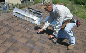 On the roof, snap a chalk line between the protruding screws to mark the outline of the cut-out.
