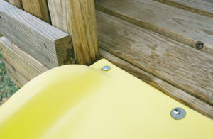 Fasten the slide to the deck with the included hardware.