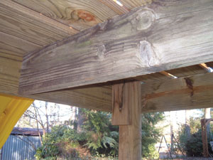 A center joist supports the decking. At the corner support posts, I added some extra blocking to provide a solid nailing surface below the deck boards at the platform's edge.