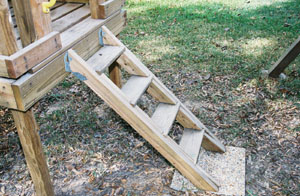 Simple steps can be built from 2x4 stringers, blocking and 1x6 treads. Mount the steps with metal hangers.