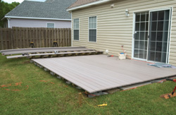 With the low deck joist system in place, you can use standard decking techniques to complete the job. Use a nail to space the decking boards and fasten with the appropriate length screws.