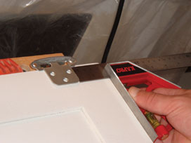 Use a combination square to make sure you keep the hinges and handles consistently spaced when installing the hardware.