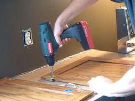 Remove the doors and all hardware. Label the doors by number to keep track of their placement.