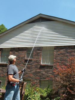 The Ladder-Saver nozzle shown adds 40 feet of reach to the pressure washer's stream.