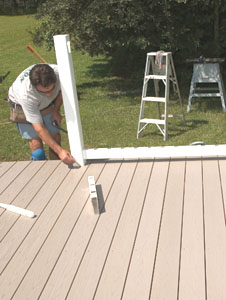 The bottom rail can be used to layout the newel posts. This is much easier than working with assembled rail sections.