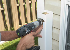Pre-drill the 2x4 with a hole that clears the lag bolt threads.