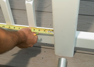 Measure the distance between the end baluster and the newel. Keep this measurement consistent throughout the rail system.