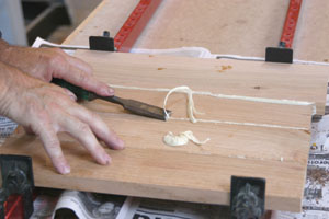After about 30 minutes, use a sharp chisel to cut away the excess foamed polyurethane adhesive.