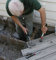 Remove the decking carefully so that you don't inadvertently damage the underlying structure. By using a crowbar and cat's paw instead of a reciprocating saw, much of the 2x6 decking was salvaged for other projects around the yard.
