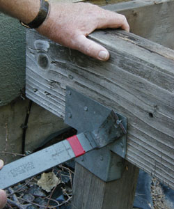 If a beam appears cracked or severely rotten, it should be removed and replaced with pressure-treated wood. Carefully pull out nails before prying out bad boards so that you can simply drop in its replacement.