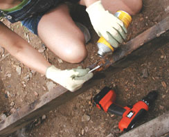 Leaves and other debris trapped between the decking had started to encourage rot along the tops of some of the joists. To seal the wood from further damage, apply a wood hardener or epoxy consolidate.