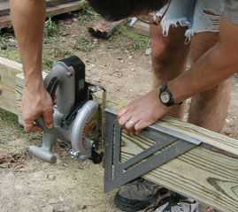 Use a triangular square and the weight of the saw to ensure a square-cut end.