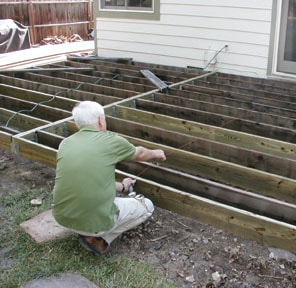 To reduce that bouncy feeling, snap a line at the center of the joists and nail in blocking between the joists.