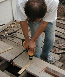 Composite boards bend unpredictably. Use clamps to force them into submission until they are safely secured by screws.