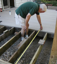 """Measure the """"to go"""" distance every so often to make sure that your decking is perfectly perpendicular to your joists. Minor adjustments made on a few planks can invisibly correct wayward boards."""