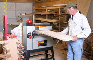 The glued-up halves are smoothed. The best tool is a drum sander. The Craftsman Drum Sander shown will take an 18-inch-wide board, or sand a 36-inch-wide piece of stock.