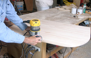 The top and bottom front and end edges of the countertop are rounded using a 1/2-inch rounding bit in a router.
