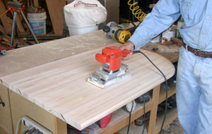 The top is sanded smooth with progressively finer grits of sandpaper.