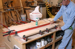 The two halves are then clamped together. In order to clamp the end with the corner removed, the bandsawed corner piece is dry-clamped in place to provide clamping support.