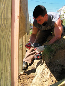 Start the decking at the top and work your way down. This ensures that all but the last boards, wich finish in the ground, will be even. Drive a nail or screw 1/3 of the way in as a cleat to help hold up long boards. make sure decking material is dry before installing.