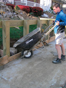 The best way to get the concrete to flow around the post bottoms is to mix it in a wheelbarrow and pour it in. make sure to hose down all posts, sidewalks, grass, etc. after finishing to dilute spillage.