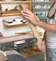 A drum or spindle sander is used to sand all curved surfaces.