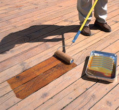 Usually a good oil-based stain can be applied with a brush, roller or sprayer.