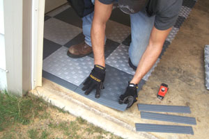 Install beveled edging at the end of the floor, staying clear of the garage door.