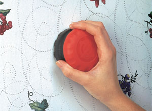 Other wallpaper may be harder to remove. The first step is to score the old paper with a Zinsser Paper Tiger Scoring Tool. The more holes you make, the faster and easier the paper will come off.