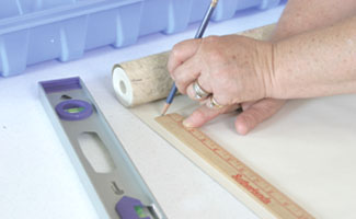 Roll the paper out on a long table and measure for length, adding for the top and bottom.