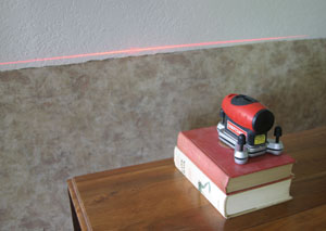 "Wallpaper can also be used as a ""wainscoting"". A laser level can be used to establish a level line around the room."