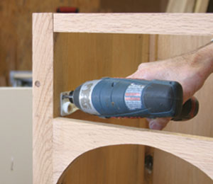 Fasten the case drawer slides to the sides with a filler strip added