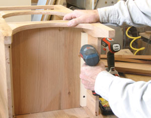 Fasten the shelf in place with glue and screws