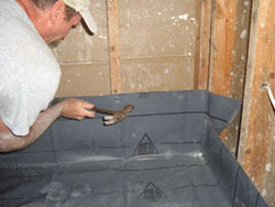 fasten the liner to the surrounding shower framing