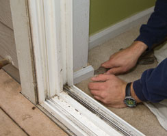 We then removed the base board that returned into the patio door frame.