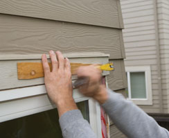 Use a scrap of wood, such as this cedar shim, to protect materials from crow bars and hammers when prying.