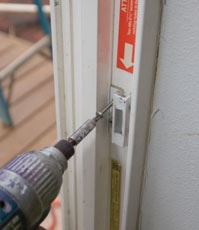 Don't forget to remove the latch mechanism from the door frame. Properly installed, the long screws go through to the framing, which means they must be removed to release the frame.