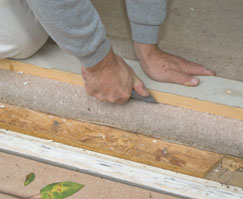 We used a straight-edge and utility knife to cut the carpet.