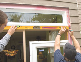 We used a level to transfer reveal marks from the door jamb to get the right header height position for the sidelite window.