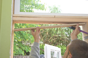 This required adding a piece of furring on the underside of the horizontal framing board to properly back the window flange.