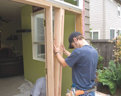 We added a vertical framing piece that extended from the floor to the horizontal frame. Note that we doubled a 2-by-6 and added spacer boards.