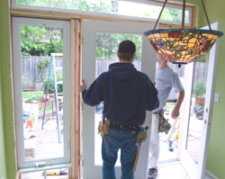 With the jamb in position but loose, we put the doors on the hinges.