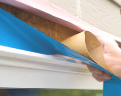 We sealed the window flanges and the door jamb to the exterior of the house with Blueskin Weather Barrier.