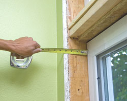 The interior trim starts with measuring the windows for window surrounds. Surrounds are four-sided boxes that transition from the windows out to the wall surface.