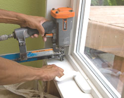 Each window surround was anchored by first shimming and nailing near the corners and then using a straight edge to align the boards from corner to corner.