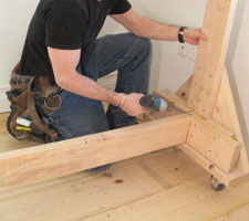 "Pack out the angle braces with 6"" blocks, then laminate with 2x6 shelf support blocks."