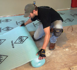 Unroll the foam underlayment and join the butted seams with duct tape.