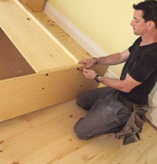 Install the headboard, making sure the face-side is facing the floor, and orient the side you want as the top, facing the top of the bed assembly. Install the headpiece on the bed frame assembly by simply snugging the provided screws through the pre-drilled holes. Do not overtighten.