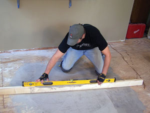 Make sure the subfloor is level. The floor shown required a Portland cement-based leveling compound.